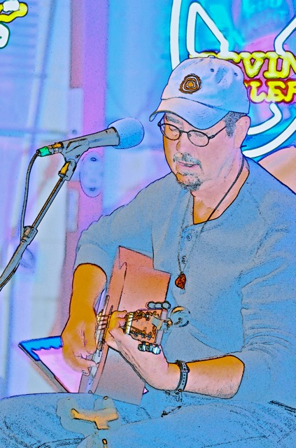 Jim Stricklan playing at Hills Cafe - photo art by Rick Stricklan